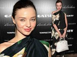 Floral flapper! Miranda Kerr knocks it out of the park (literally) in orchid print jumpsuit at yet another Great Gatsby screening