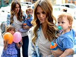 Back to mommy duty! Jessica Alba checks out of New York hotel with her two daughters in tow after glamming it up at Met Gala AND The Today Show