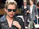 Get much sleep last night? A weary-looking Michelle Williams leans on her gal pal during stroll through New York