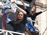 Watch out, Jake! Gyllenhaal's rumoured girlfriend Emily DiDonato threw her boyfriend's clothes off of a fire escape while filming an upcoming Maybelline commercial in New York City on Wednesday