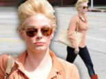 Bouffant blunder! Rose McGowan steps out in a voluminous updo that falls flat by the end of the day