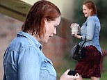 It must be dirty work! Christina Hendricks emerges from her trailer with wet hair and no make-up after filming with Ryan Gosling