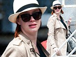 Staying undercover! Christina Hendricks goes incognito in trench coat, hat and sunglasses in a break from filming Ryan Gosling movie