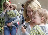 Sunglass inspector: January Jones held one-year-old son Xander on Wednesday as he examined her shades