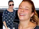 What a difference a pair of shades make! LeAnn Rimes shows off her make-up free face as she arrives in Toronto