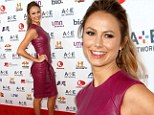 Fruity little number! Stacy Keibler is ravishing in a tight wine-coloured leather peplum dress