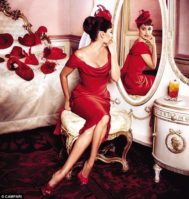 Titfer tat: A scarlet hat is a crowning glory for Penelope