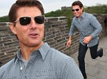 Springing into action! Tom Cruise mobbed by fans as he sprints down Great Wall of China while promoting Oblivion in Beijing