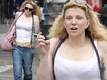 Brace yourself! Courtney Love bares midriff in bizarre ensemble of baggy jeans held up by suspenders