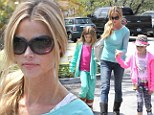 Slender Denise Richards treats daughters Sam and Lola to lunch after retaining temporary custody of Brooke Mueller's twins