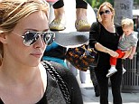 Slimming shade: Hilary Duff opted for an all-black ensemble on Wednesday as she took her boy Luca out in Beverly Hills, California
