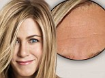 Now you see them, now you don't! Jennifer Aniston's forehead lines magically disappear with the aid of the airbrush in new haircare campaign