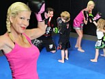 What a knockout! Tori Spelling shows how she maintains her incredibly toned figure as she takes family to boxercise session