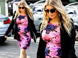 Her lovely floral lump: Fergie hugs her baby bump in a pink and blue dress and looks stunning, proving it is possible to wear floral while pregnant