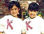 Before they were famous: Kim Kardashian strikes a pose while Kourtney is more demure in childhood snap