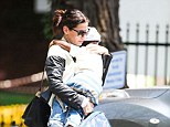 Mother and child: A leather-clad Sandra Bullock sweetly cradled her adopted son Louis after his long day at school in Beverly Hills Thursday
