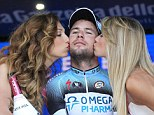 To the victor, the spoils: Mark Cavendish is kissed by the hostesses after securing his stage win