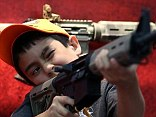 While gun control advocates cite the safety of children as a primary reason to restrict the availability of high-powered rifles and large-capacity ammunition magazines, the NRA mad the same equipment available for children to hold