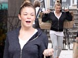 Work out anywhere! Fitness fanatic LeAnn Rimes exercises with heavy shopping bags as she leaves Whole Foods with some healthy dinner