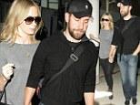 They look good in anything! Emily Blunt and husband John Krasinksi land LAX in casual style after a glamorous NYC trip