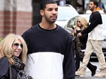 Little and large! Drake goes for a stroll with his diminutive mother Sandi in Toronto