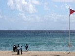 French gendarmes stand by the sea after a 36 year-old French surfer was attacked and killed by a shark today