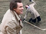 He's fallen and he can't get up! Jim Carrey collapses with a hockey stick while filming scenes for Anchorman sequel in Atlanta