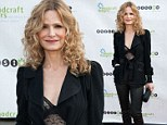 Kyra Sedgwick spices up a trouser suit with sheer lace bodysuit as she hosts youth charity gala