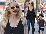 Putting their best feet forward: Sarah Michelle Gellar's daughter Charlotte is just like her mother in her little boots