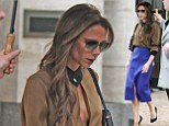 Sexy secretary style: Victoria Beckham steps out in plunging cut out blouse and vibrant purple skirt in New York