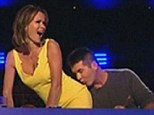 Pucker up: Simon Cowell plants a big kiss on Amanda Holden's bottom during Saturday nights episode of Britian's Got Talent