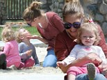 Mummy's playtime! Rebecca Gayheart has more funny on the slippery slide than her two adorable daughters