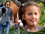 Holding on tight! Doting father Gabriel Aubry clasps Nahla's hand as he drops her off at school