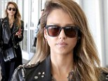 Rocker chick: Jessica Alba arrived at Los Angeles International Airport on Friday dressed in an all-black ensemble