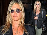 Throwing some shade! Jennifer Aniston blocks out dark New York City with even darker sunglasses