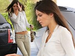 Kendall Jenner gasses up her Range Rover in Calabasas, California