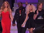 True professionals! American Idol panel get on with the job... despite reports their contracts have not been renewed