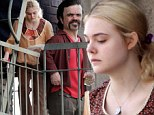 Elle Fanning and Peter Dinklage hang out on fire escape while shooting their film, Low Down