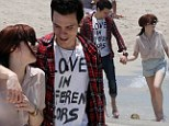 Carly Rae Jepsen cosies up to beau Matthew Koma as pair enjoy romantic beach stroll
