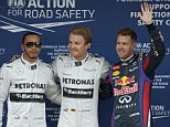 Top three drivers: Nico Rosberg stands in the middle of second placed Lewis Hamilton and Sebastian Vettel who finished in third