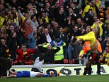 What a moment: Troy Deeney (right) celebrates the goal that took Watford to the play-off final just 20 seconds after Leicester missed a penalty