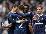 Marching on: Emmanuel Adebayor's late winner means Tottenham can continue to dream of Champions League football