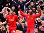 Prolific: Daniel Sturridge raises his arms to the heavens after scoring the winner for Liverpool
