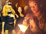 'You ain't a king!' Rihanna jabs at Chris Brown as she tweets photos of her boozy ladies night out in New York