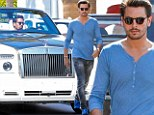 Blue boy: Scott Disick joined friends for lunch on Friday in Beverly Hills wearing a blue shirt with matching moccasins