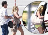 Ready to get away! Hilary Duff put her legs on display in short shorts as she and her family boarded a private jet at the Van Nuys Airport in Los Angeles, California on Friday