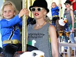 Bird of play! Gwen Stefani watches like a hawk as son Zuma spins on carousel eagle