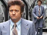 Flipping out: Jeremy Renner does the American Hustle in retro hairdo and cool blue suit but it's just for his new movie