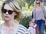 Her own little Mad Man! January Jones takes her son Xander for a walk in the sunshine, and he decides it's his turn to play tour guide