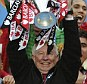 Ferguson lifts the Premier League trophy in his final home game in charge